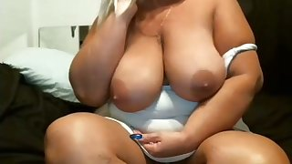 This mature slut is hot and I'd love to fire my cumshots all over the brush phat tits